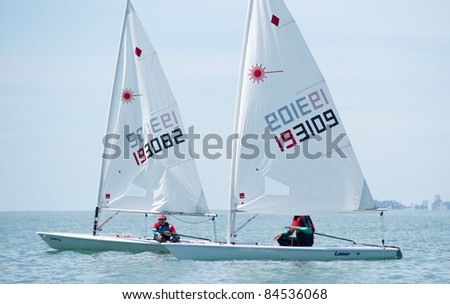 CHA-AM THAILAND - AUGUST 22: Two unidentified sailors compete during Day 1 of the 2011 Hua Hin Regatta on August 22, 2011 at Dusit Thani Resort & Spa Hua Hin in Cha-Am, Thailand