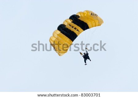 CHA-AM THAILAND - MAY 10: Member of Royal Thai Armed Force Parachute team performs during 2010 Royal Thai Armed Force Parachuting Competition on May 10, 2010 at Naresuan Army Based in Cha-am, Thailand