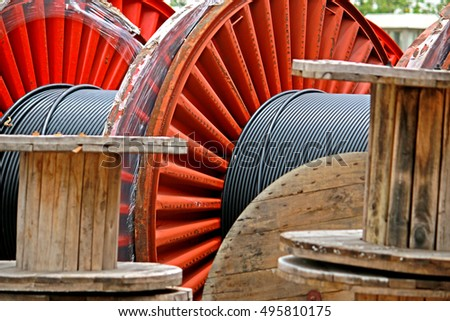 CHACHEANGSOW-THAILAND-AUGUST 26 : Old Steel & wooden reels of power electrical cable arrangement in warehouse August 26, 2015, Chacheangsow Province, Thailand