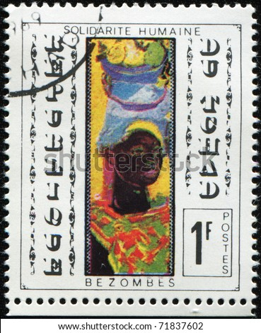 CHAD - CIRCA 1969: A post stamp printed in Republic of Chad shows draw by Bezombes - Portrai of black woman, circa 1969 - stock photo