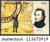 CHAD - CIRCA 2000: A postage stamp printed by Chad shows image portrait of famous Italian violinist, violist and composer Niccolo Paganini, circa 2000. - stock photo