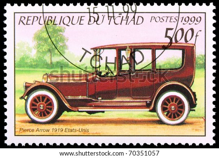 CHAD - CIRCA 1999: A stamp printed in Chad showing vintage car, circa 1999 - stock photo
