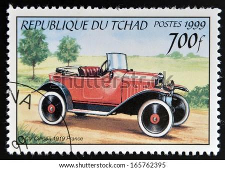 CHAD - CIRCA 1999: A stamp printed in Chad shows retro car Citroen 1919, France, circa 1999  - stock photo