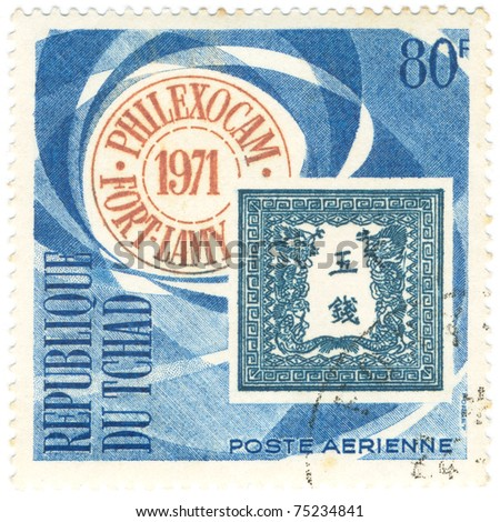 CHAD - CIRCA 1971: A stamp printed in Republic of Chad Publicity for PHILEXOCAM, devoted Post Office Japan and shows emblem, series, circa 1971 - stock photo