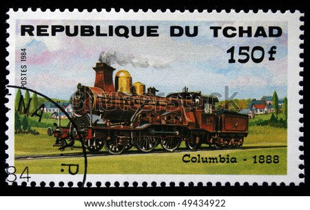 CHAD - CIRCA 1984: A stamp printed in Republic of Chad shows engine Columbia, 1888, circa 1984 - stock photo