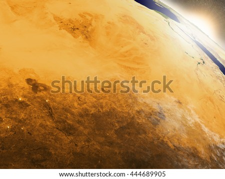 Chad with surrounding region during sunrise as seen from Earth's orbit. 3D illustration with highly detailed realistic planet surface, clouds and city lights. Elements of this image furnished by NASA. - stock photo