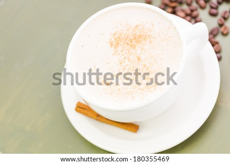 Chai tea latte with cinnamon stick. - stock photo