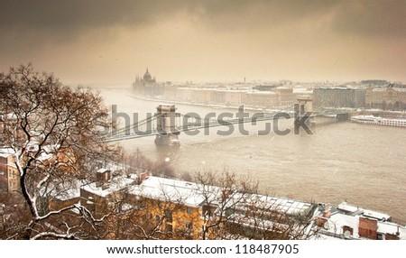 Chain Bridge and the city in winter - stock photo