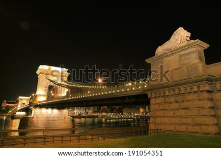 Chain bridge and the lion statue decorating it at night, Budapest, Hungary - stock photo