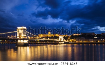 Chain bridge at night in Budapest from Pest side,  in the background the Mathis Church  visible. Hungary. - stock photo