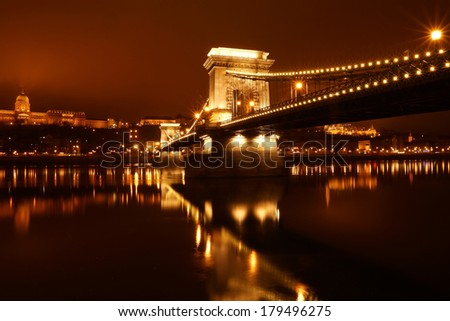 Chain bridge at night on the Danube River, Budapest, Hungary. - stock photo