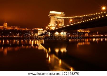 Chain bridge at night on the Danube River, Budapest, Hungary. - stock photo