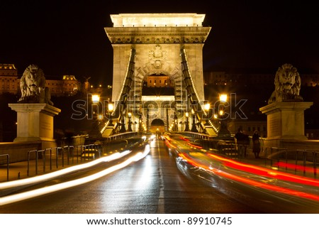 Chain bridge at night with cars in Budapest, Hungary
