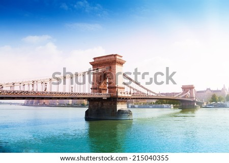 Chain bridge crossing Danube river in summer time in Budapest, Hungary - stock photo