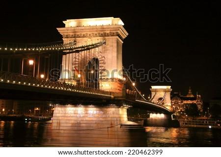 Chain bridge illuminated by decorative lights at night, Budapest, Hungary - stock photo