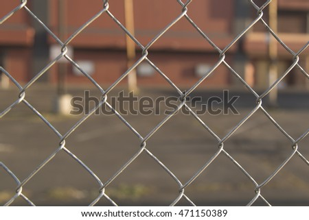 Chain Link Fence with building blurred in background