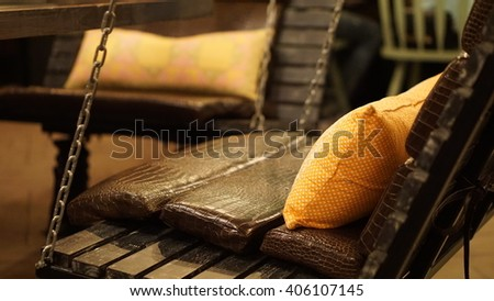 Chain link fence with orange pillows in the night club - stock photo