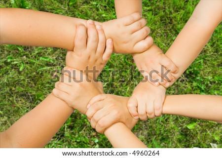 Chain of children's hand - stock photo