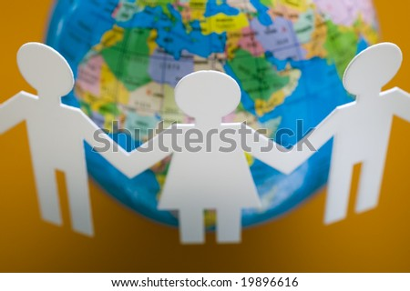 Chain of figures around the globe - stock photo