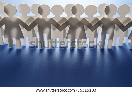 Chain of paper cutout people - stock photo