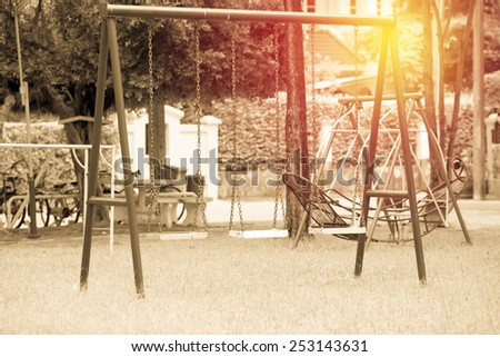 Chain swing in children playground. Vintage filter. - stock photo