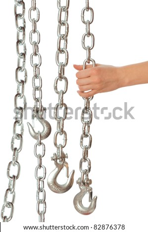 chain with a hook in the hands of crane operator at construction site
