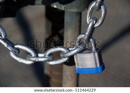 Chained and padlocked gate is used as security and protection concept.