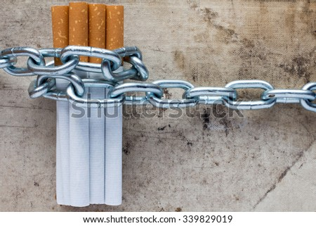 Chained cigarettes. Conceptual image for stop smoking - stock photo