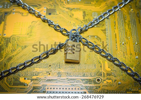 chained circuit board - data protection concept - stock photo