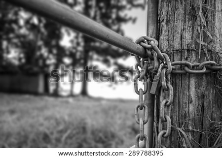 Chained Gate on Farm in Black and White - stock photo