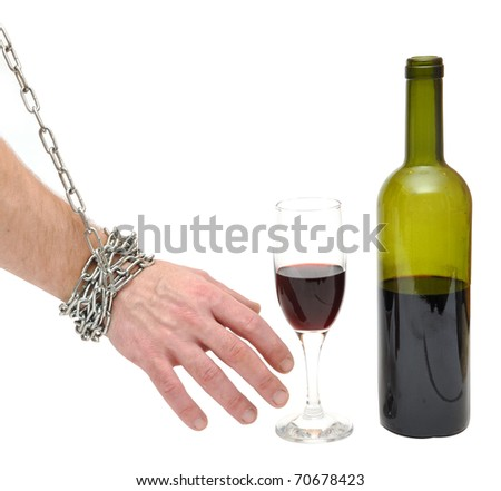 chained hand reaches for the bottle - stop alcoholism concept