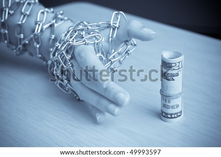Chained Hand Trying to Steal Money (Financial Security) - stock photo