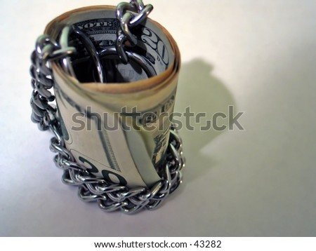 Chained Money - stock photo