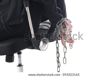 Chained up business woman on office chair isolated on white background  - stock photo