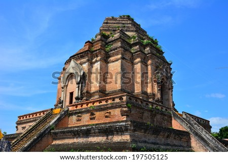 CHAING MAI - MAY 11, 2014 : Wat Chedi Luang is a Buddhist temple in the historic centre of Chiang Mai, Thailand. This temple ruined  is quite similar with Pa Hto Taw Gyi or Mingun Temple in Myanmar - stock photo