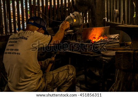 CHAING MAI,THAILAND-JULY  09,2016: Blacksmith work a Retro smithy in Chiang Mai province Thailand.