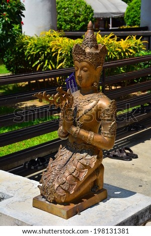CHAING MAI, THAILAND - MAY 11, 2014 : A greeting angel at Wat Chedi Luang is a Buddhist temple in the historic centre of Chiang Mai, Thailand. - stock photo