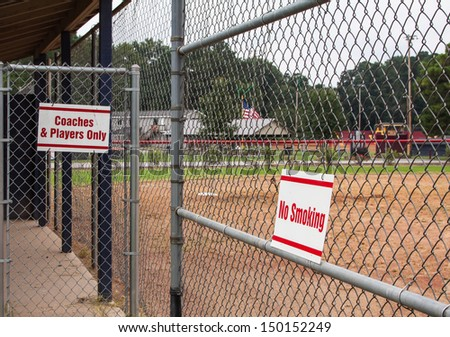 chainlink fence at youth sport park - stock photo