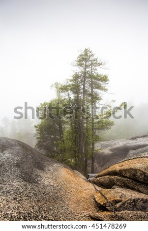 Chains for climbing the first peak of stawamus Chief hiking trail in Squamish, British Columbia, Canada - stock photo