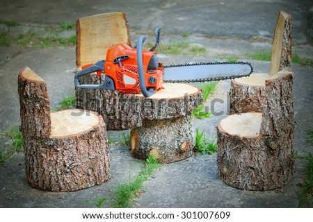 Chainsaw and carpentry products. Garden table and chairs from spruce logs. - stock photo