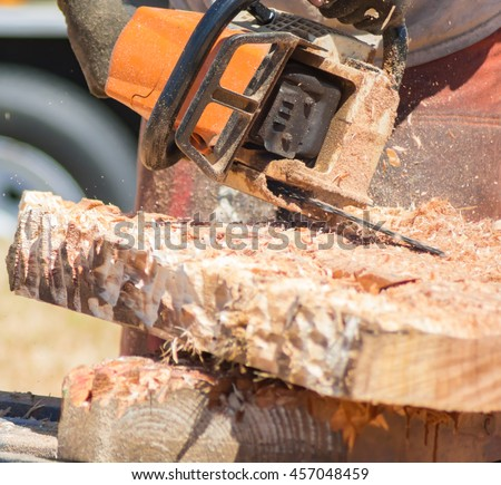 Chainsaw Carving Wood with Flying Wood Chips
