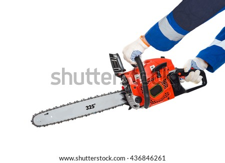 Chainsaw in hand saws a log. isolated