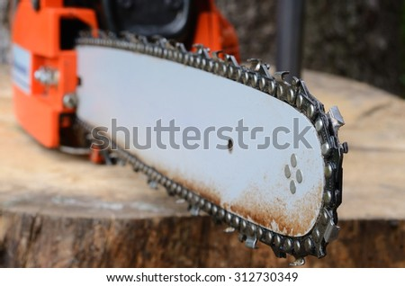 chainsaw on the stump - stock photo