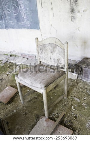 Chair abandoned house in ruins, blight - stock photo