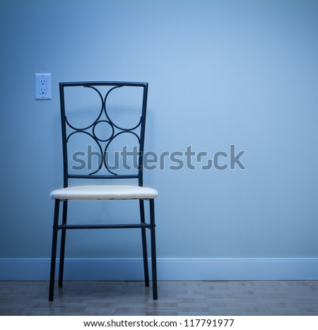 Chair against wall in a new apartment