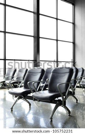 Chair airport ; Waiting at the airport for departure. - stock photo