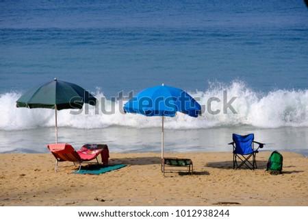beach umbrella and chair. Fine Beach Chair And Beach Umbrella On Sand With Blue Sea Wave Background Throughout Beach Umbrella And Chair
