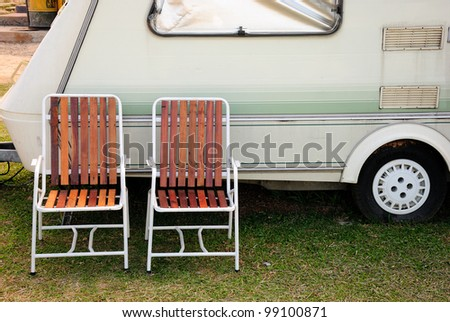 Chair and camping car - stock photo