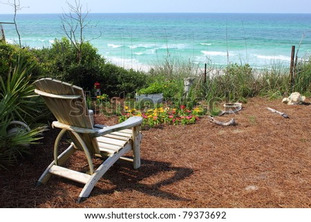 Chair and Flower Garden with Ocean View - stock photo