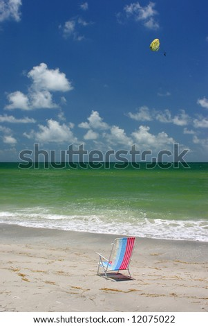 Chair and parasail in Florida Gulf Coast. Madeira Beach Florida - stock photo